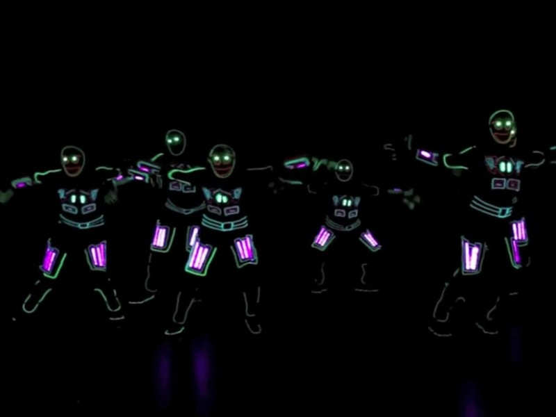 dancers in a light show
